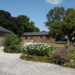 Stowford Lodge Holiday Cottages, view of Log Cabin